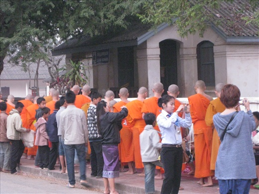 The daily early morning circus of giving alms to the monks.