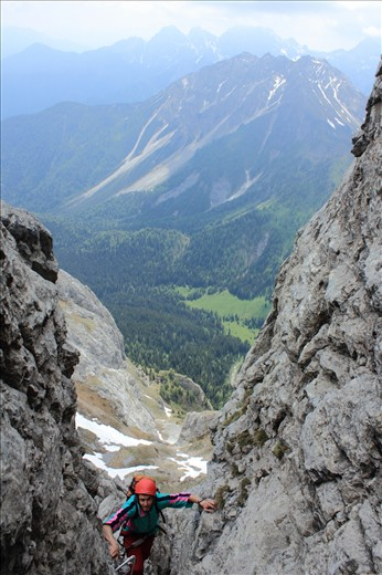 Climbing up a famous Italian  'via Ferrata' on Dolomite mountain Cliffs