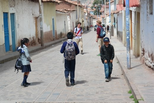 Yanapay children and volunteers on the streets of Cusco