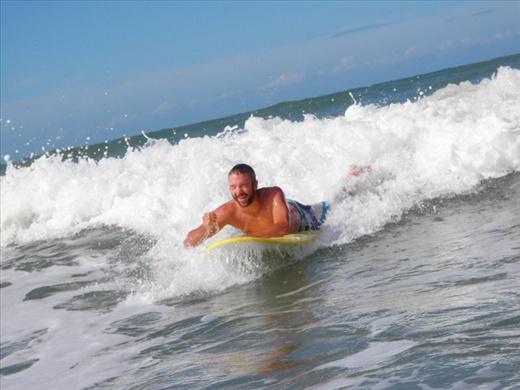 Having a great time learning to surf in Punta del Diablo, Uruguay