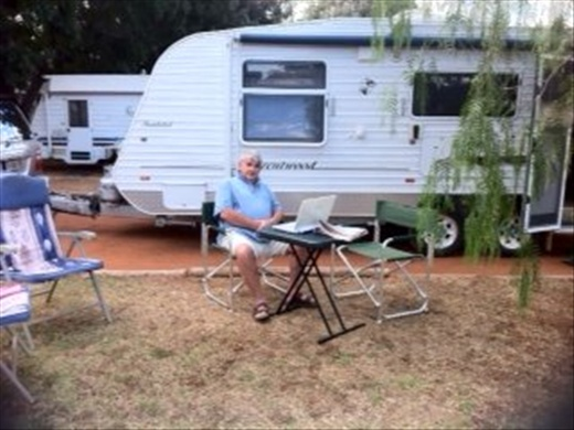 Russ in the dust with caravan at Queensland-Northern Territory border