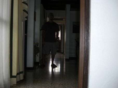 The hallway leading to the kitchen, the outside, and my house parents room downstairs...