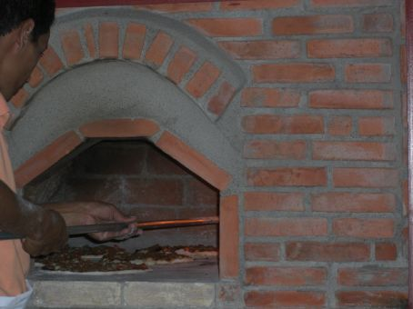 our pizzas being cooked by a wood stove at this little family house in Guanacaste
