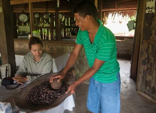 We are shown by our guide Eric, how they grind cocoa seeds to make chocolate.