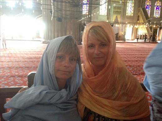 Infidels allowed in the Blue Mosque. Of course without shoes and with head cover. Tomie was given a skirt wrap to cover her knees too. Her skort was about an inch above her knees.