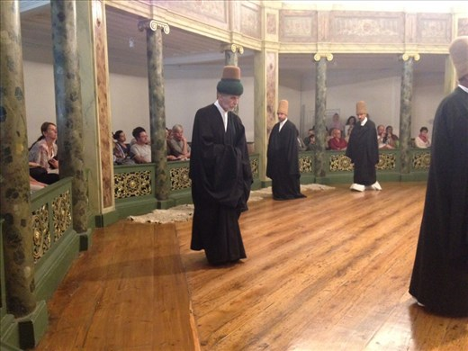 The beginning of the Sema ceremony of the whirling dervishes. This man is the revered master.