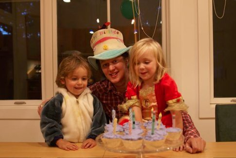 So.. a dolphin, a drummer and a princess walk into a bar.....and order - vanilla cupcakes with purple icing...Jemima, moi and Paige on my birthday, custom cupcakes, a birthday tradition of wearing the crazy hat, and much Lewis Carol referencing...