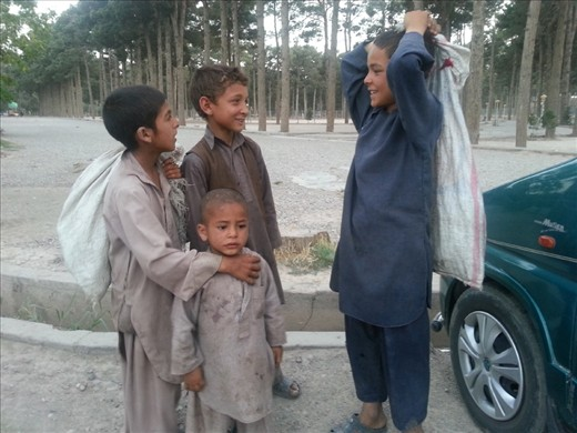 ُStreet working children asking about their daily income,