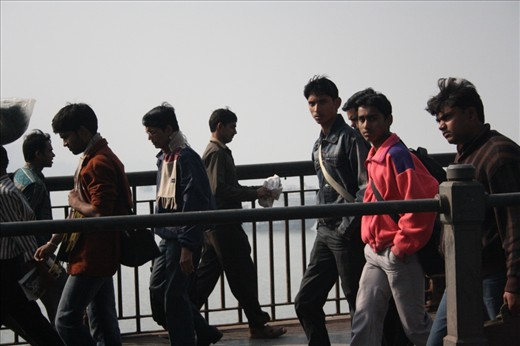 Youths are going to work at 8' o clock crossing the Ganga river in Kolkatta, India.