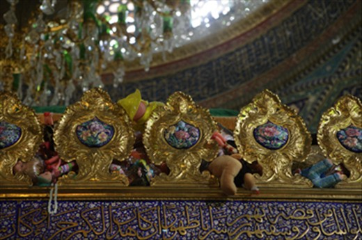 Sayyedah Rokaya's ornate shrine covered in toys as offereings