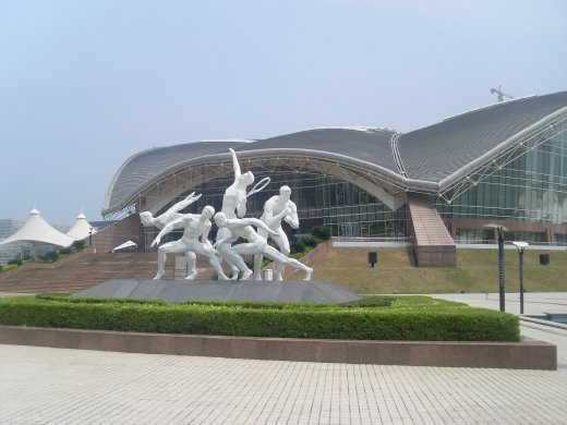 a statue outside a big ass building! concert or sports hall type thing i think!