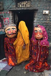 A Rajasthani woman walks past two large size Welcome Puppets: by sanam123, Views[260]