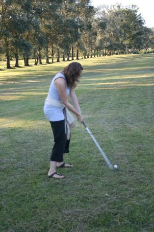 Attempting a golf shot.