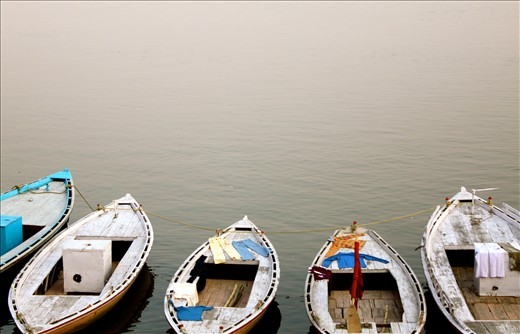 Boats along the Ganga offering a drying spot for laundry.
