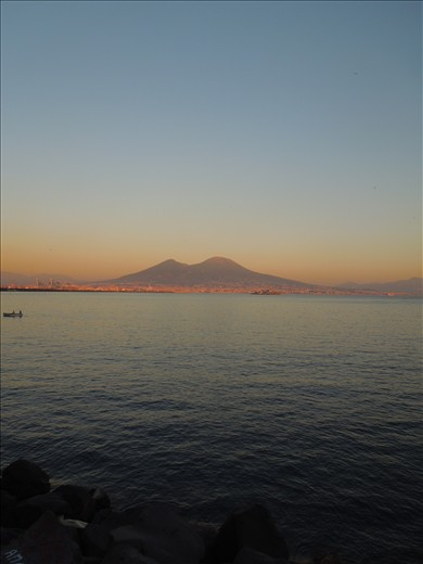 The Vesuvius at sunset takes a special beauty wraps in the red of clouds.
