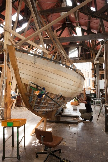Adrian's student works on 'Peggy', continuing the traditional craft of boat building.