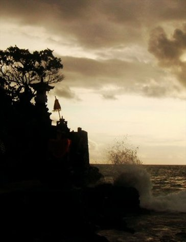 sun setting at brahma's shrine at batu bolong temple