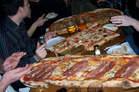 The Pizzas were too big to fiton the tables