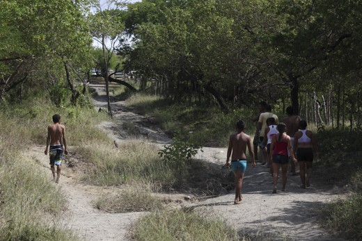 Group of people going up to the mud volcano in Arboletes, Colombia.