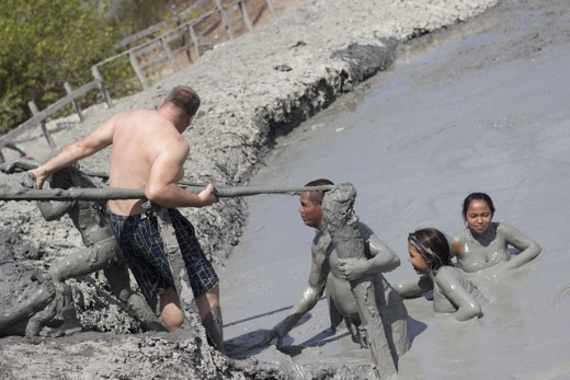 Getting in and out of the mud volcano. Mud is heavy, some people will help you.