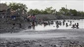 The mud volcano. People encourage a man to come down, it's 40m diam*40km deep!!: by sebastianoc, Views[732]