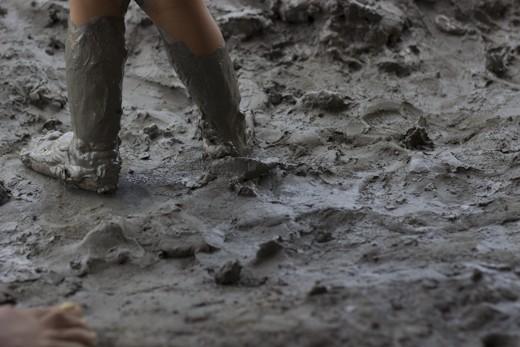 A child's muddy feet.