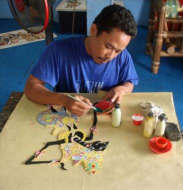 Painting shadow puppets, Yogyakarta
