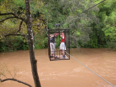 Rank stupidity! Crossing a river in a shark cage on our trekking experience