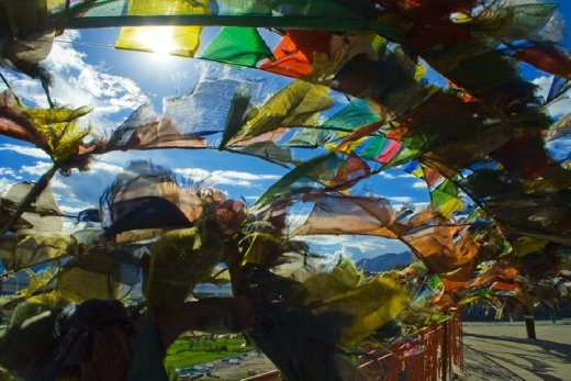 Worn and weathered by sun and wind, curtains of prayer flags representating the five nature elements,are used to promote peace, compassion, strength, and wisdom. By hanging flags in high places the