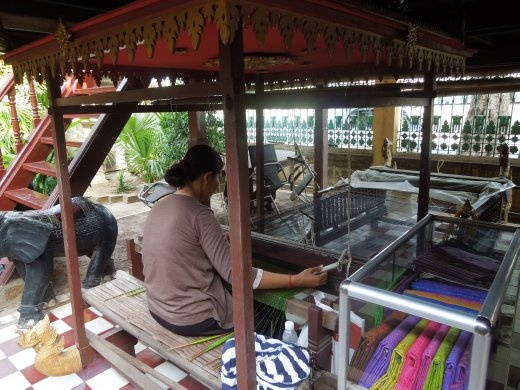 As we excited the Palace grounds- they have a whole area set up for exhibits on Cambodian arts, crafts, & other cultural aspects- this woman was weaving scarves on this giant loom