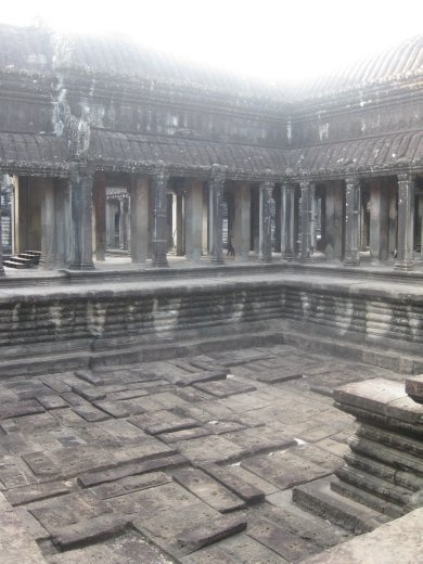 Inside Angkor Wat! This big basin would have been filled with water for monks' use and rituals-- there were 4 of these basins on the 1st level