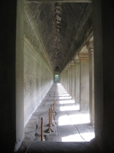 Corridors along the lowest/outermost level of Angkor Wat-- they are covered in carved bas-reliefs all the way around which you can walk around and 'read'