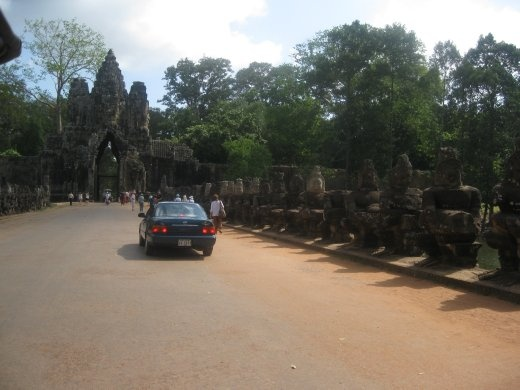 Driving across the moat to the gateway into the Royal Palace complex known as Angkor Thom. It's a huge area encompassing more temples and at one time, the Palace. (See the Demons holding the big snake again along the bridge- Churning the Sea of Milk)