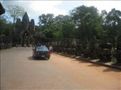 Driving across the moat to the gateway into the Royal Palace complex known as Angkor Thom. It's a huge area encompassing more temples and at one time, the Palace. (See the Demons holding the big snake again along the bridge- Churning the Sea of Milk): by sglass, Views[64]