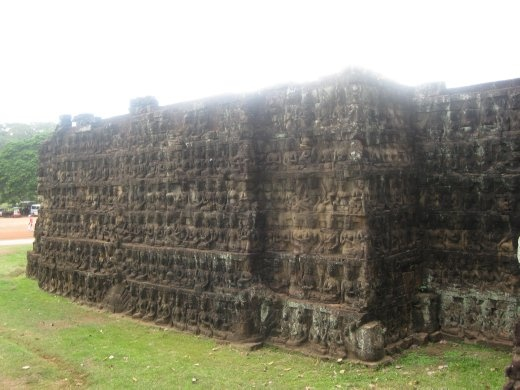 Standing outside the terrace wall