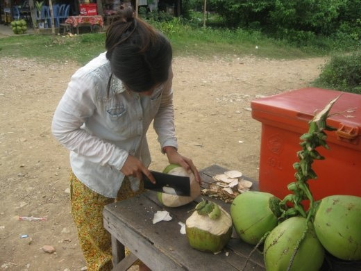 Stopped in a village where a local woman invited us to have drinks in her house... I had a coconut!