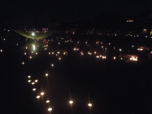 Hundreds of paper lanterns floating on the river