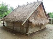 A traditional Hmong house- no stilts and no windows. Religious beliefs differ from tribe to tribe, but many of the Hmong worship spirits (phi) and believe that having windows will enable bad spirits to get into their houses.: by sglass, Views[1735]