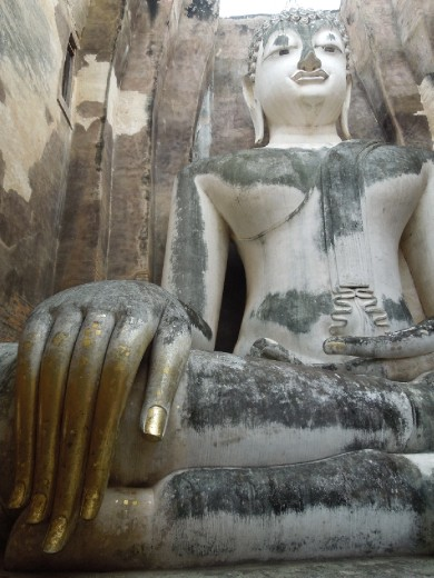 Famous tapered fingers of the Buddha at Wat Si Chum