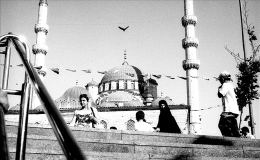 Coming out of the subway at the most famous Eminounu plaza (opposite the Bosphorus banks).  This subway is most frequently used by people. The bird above the mosque just caught my eye, which had been hovering around for sometime. There was some striking relation between the women clad in burkha and the bird.