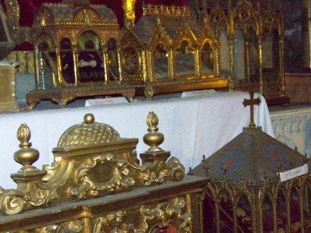 gold ornate boxes full of saint relics