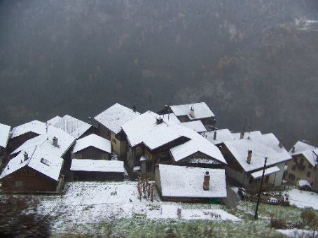 small town perched on the side of the mountain in Switzerland
