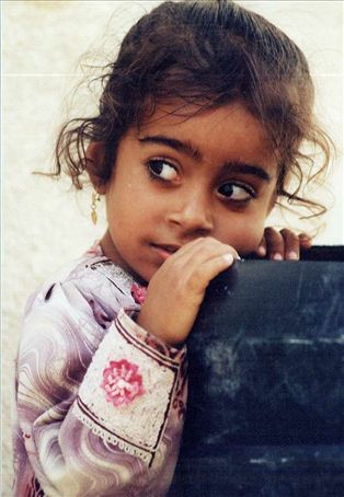 An Omani girl with the most beautiful eyes in the Musandum Peninsula.