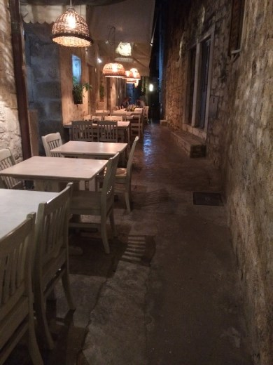 A typical restaurant setting on a narrow street!