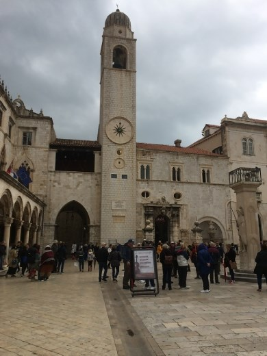 Main square in Dubrovnik with a very clever clock tower telling time in just about every manner possible.