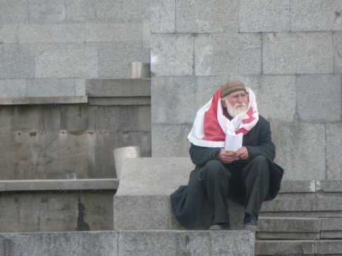 An elderly patriot waiting patiently on the steps of Parliament for the anti-government protests to start the following day (April 9)