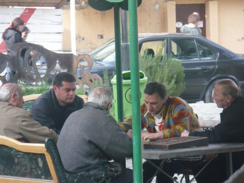 Local men playing a fierce game of backgammon