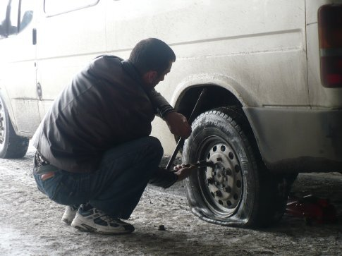 The road was half-filled with icy/watery potholes and several vehicles got stuck inside one particular tunnel, including our marshutka... we also popped a tire