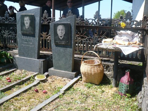 On Easter Sunday, it's tradition to visit family members' gravesites. They place various items of symbolic importance on the graves such as the red eggs, slices of bread, and candles, and sometimes even a splash of wine