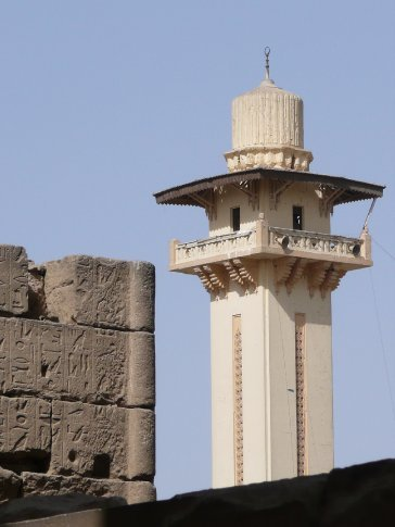 A contemporary minaret just beyond the temple